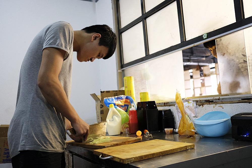 Xia Tian, 19, works in the kitchen of a Korean restaurant near Sichuan University in Chengdu.