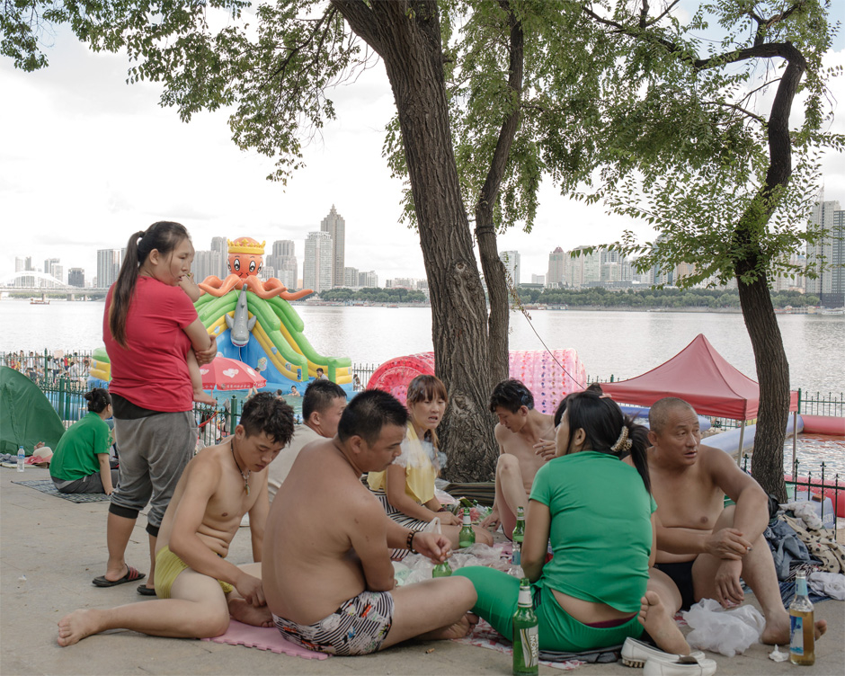 A group of Chinese people picnic on the bank of the Songhua River in Harbin. Formerly a small fishing village, the city expanded rapidly in the 19th century as Russian engineers constructed the eastern portion of the Trans-Siberian Railway.