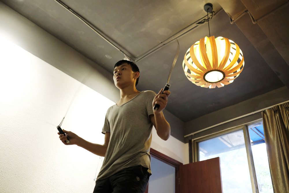 Xia trains by skipping rope in his dormitory.