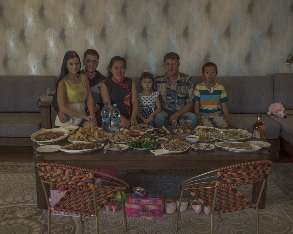 Li Lihua and her husband Vadim sit with family members in their Blagoveshchensk home. Li moved to Russia from Harbin in 1993 after the Soviet era ended and migration was once again possible. Today, she runs a successful business in construction and restoration. Prior to the mid-19th century, most Chinese migrants to Russia were convicts, hunters, fishermen, or traders.