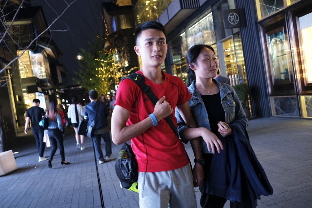 Bo Junhui, 18, shops with his sister on Chunxi Road in Chengdu.