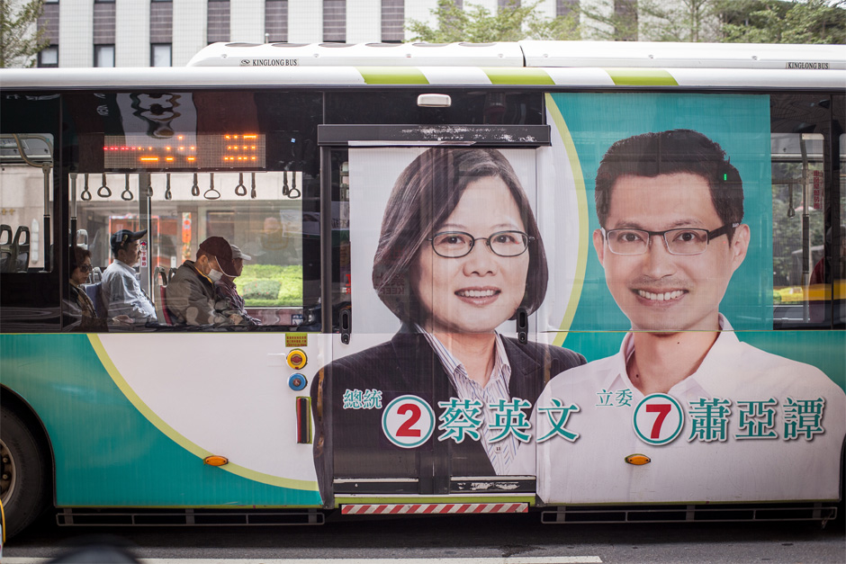 Political advertisements appear everywhere during election season. Here, a bus in Taipei displays Tsai Ying-wen endorsing parliamentary candidate Xiao Ya-tan.