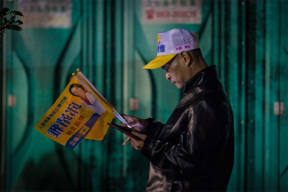 A Minkuotang rally-goer takes a cigarette break in Zhubei City.