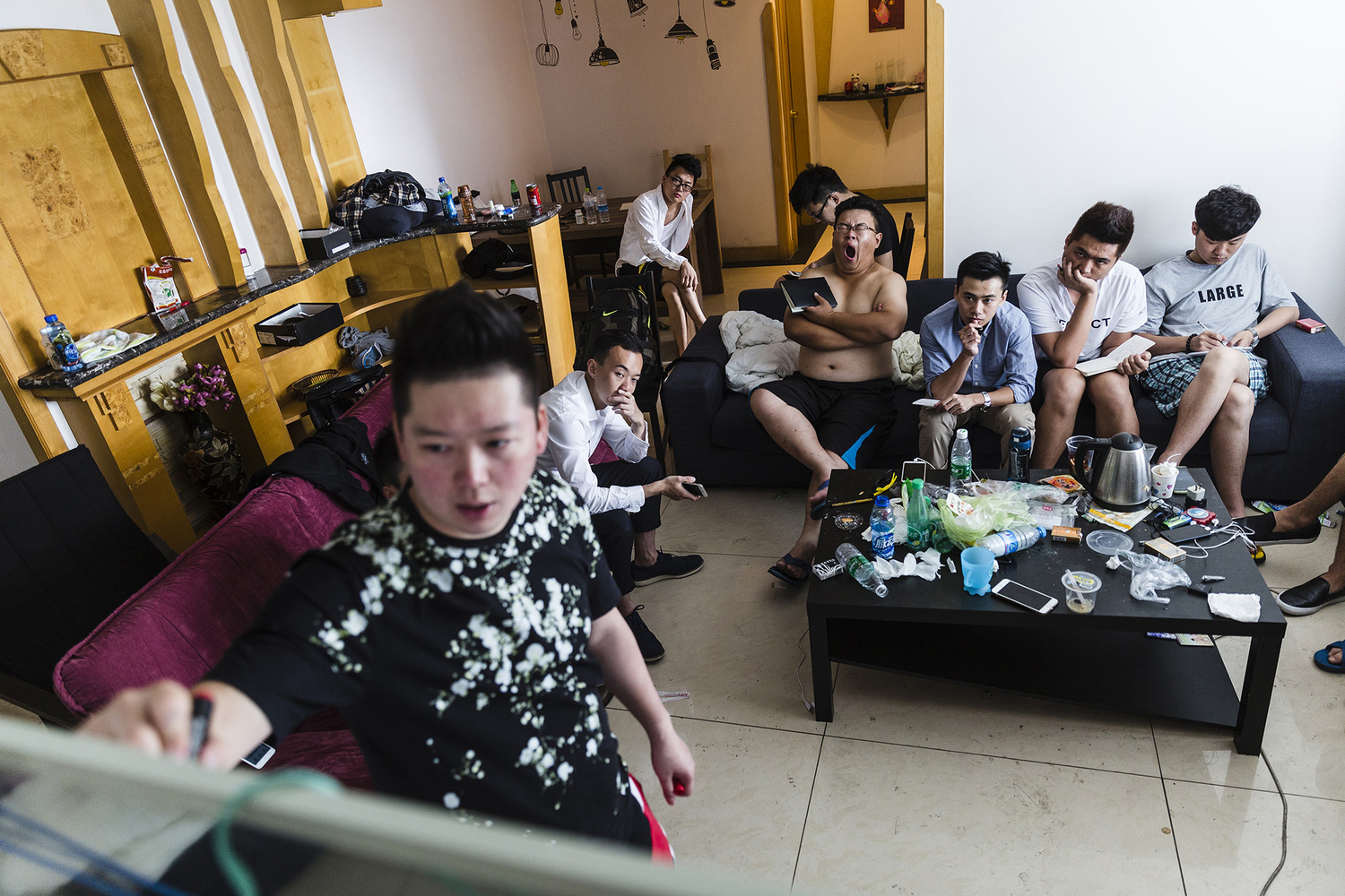 Wang Huanyu founded Puamap, a program that purports to teach its students how to seduce women. He introduces a program on the first day of training, in the three-bedroom apartment where the 12 students and three mentors study and live together, in Chengdu, May 16, 2015.