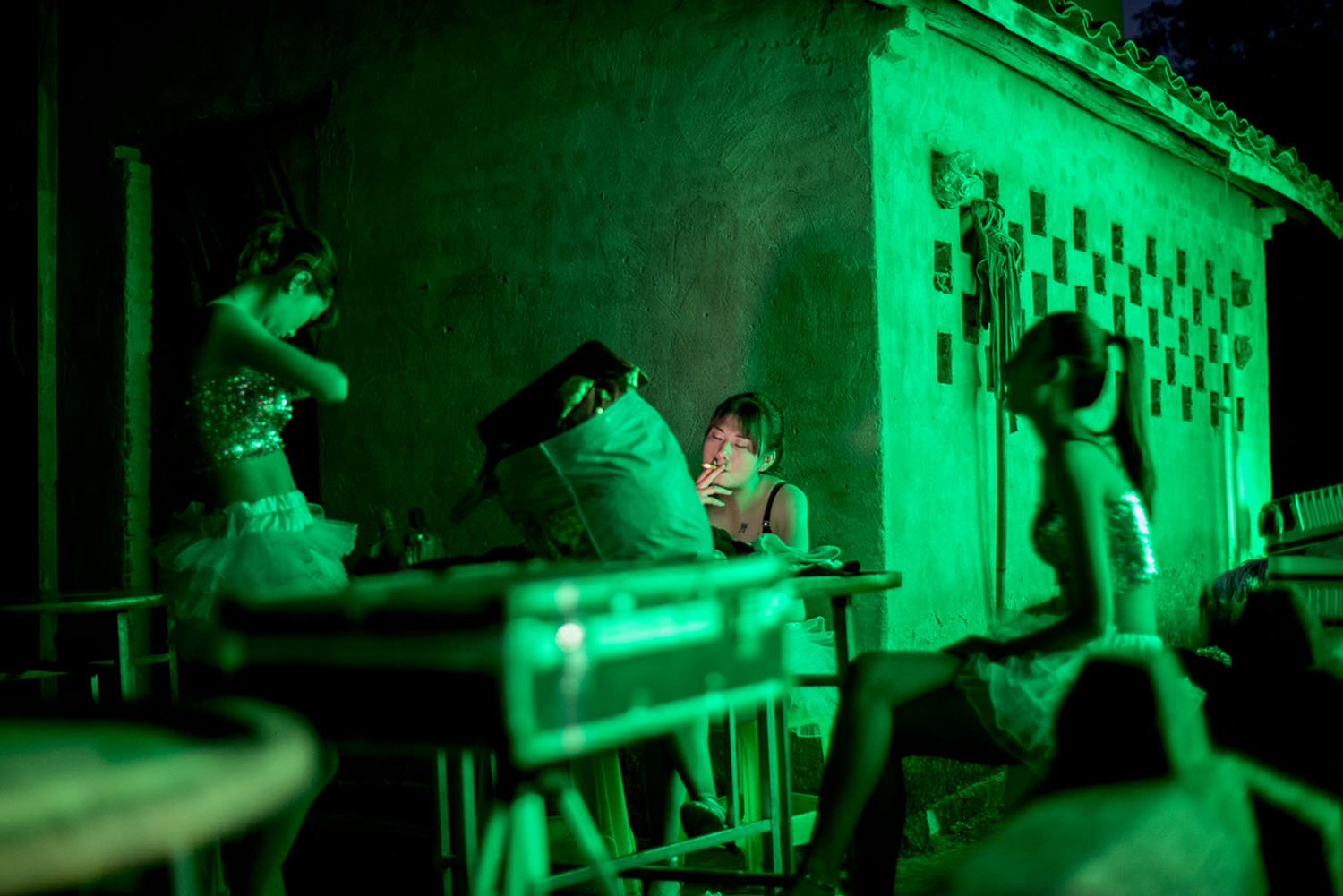 Dancers wait backstage at a funeral performance, May 26, 2016.