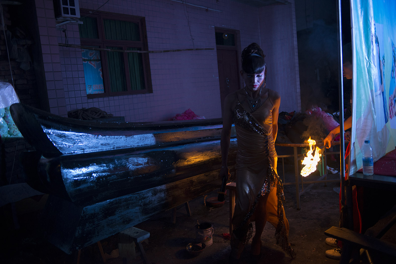 Liangzi walks in front of a coffin, October 28, 2014.