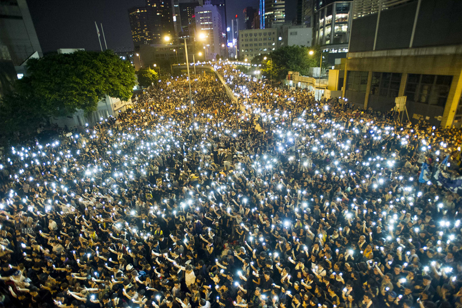Protesters gather in the streets outside the Hong Kong government headquarters on September 30. Thousands of pro-democracy supporters have remained in the streets of Hong Kong for days of protests. (Photo by Xaume Olleros/AFP/Getty Images)