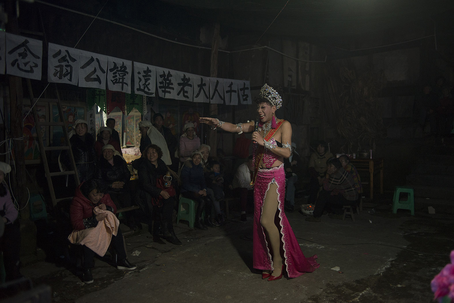 Drag queen Lala, 42, performs at a funeral in Qijiang district of Chongqing municipality, February 28, 2017. Lala is a friend of Liangzi, and she became a funeral performer around 2002.