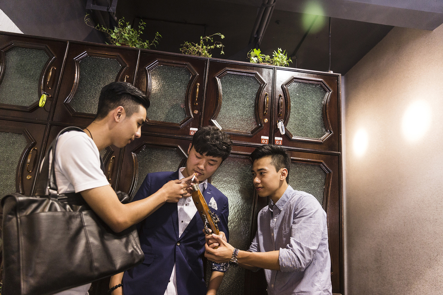 After updating his hairstyle, Jiang (center) poses for new profile photos for his social media accounts, May 15, 2015. Improving one's online presence is an important part of Puamap's course.