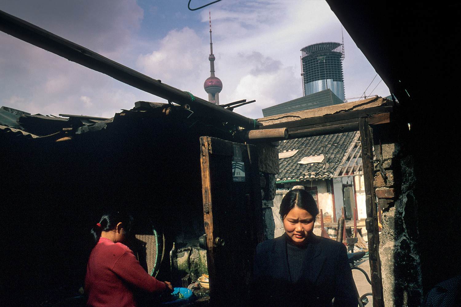Homes vacated by residents to make way for construction projects were occupied by people from the countryside who came to Pudong to cater to the needs of construction workers, 1996.