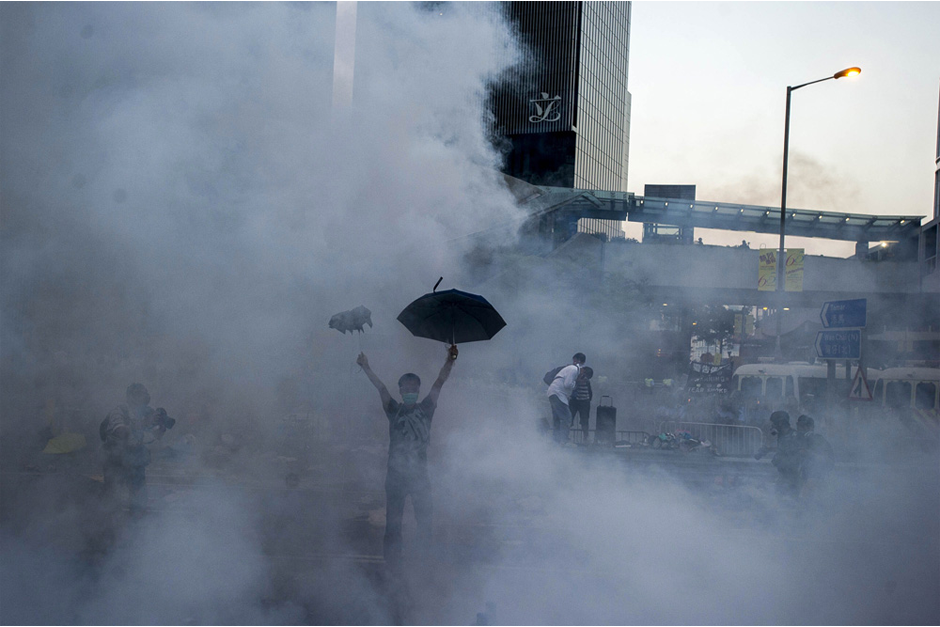 A pro-democracy demonstrator gestures after police fired tear gas towards protesters. (Photo by Xaume Olleros/AFP/Getty Images)
