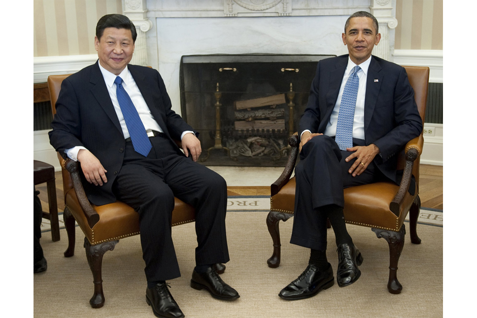 Chinese then Vice President Xi Jinping and U.S. President Barack Obama speak during meetings in the Oval Office of the White House in Washington, D.C., February 14, 2012. Obama received the Chinese leader-in-waiting following Xi's meetings earlier in the day with Vice President Joe Biden and Secretary of State Hillary Clinton. (Photo by Saul Loeb/AFP/Getty Images)