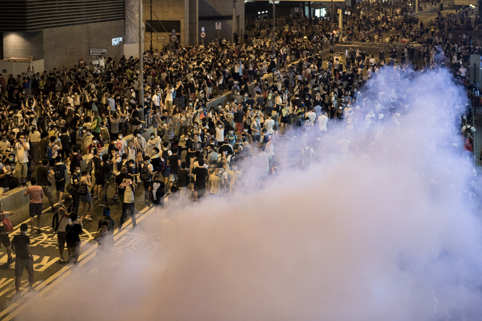 Police fire tear gas. (Photo credit by Alex Ogle/AFP/Getty Images)