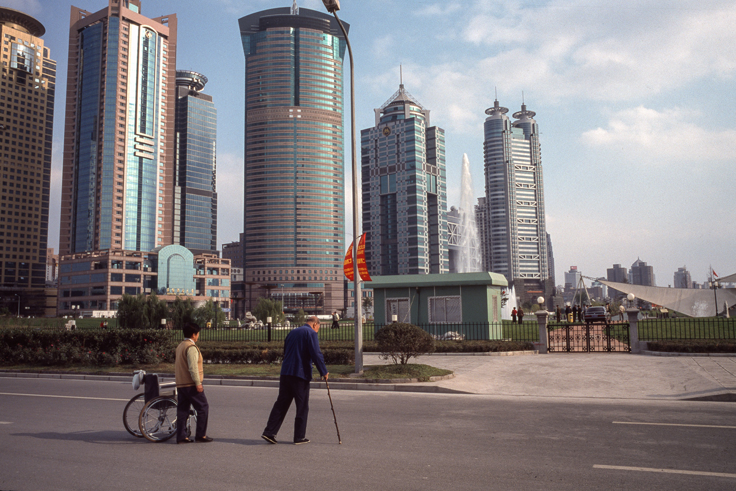 Two elderly people cross Yincheng Road to the Central Green, 2003.