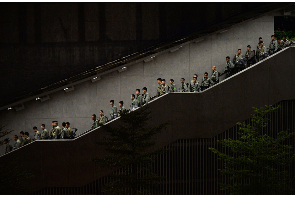 Police walk down a stairwell. (Photo by Dale de la Rey/AFP/Getty Images)
