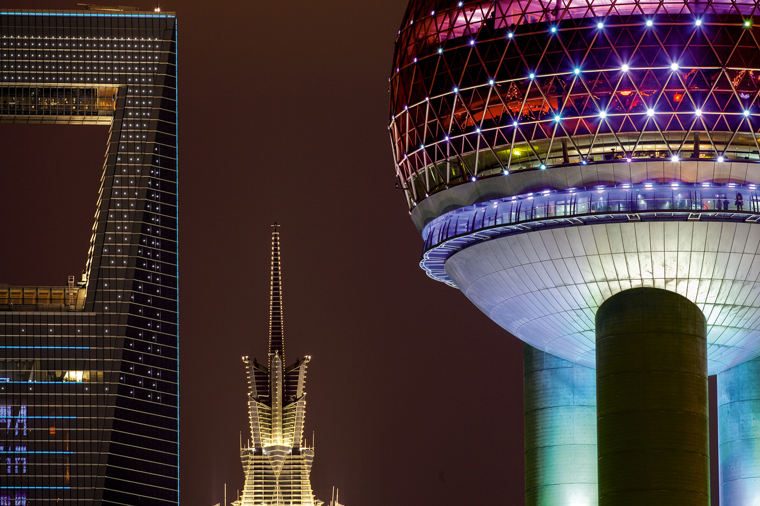 Three generations of architecture—the oldest, the Oriental Pearl Radio & TV Tower, right; the Jin Mao Tower, center; and the Shanghai World Financial Center—have become signature buildings in Shanghai's skyline, 2010.