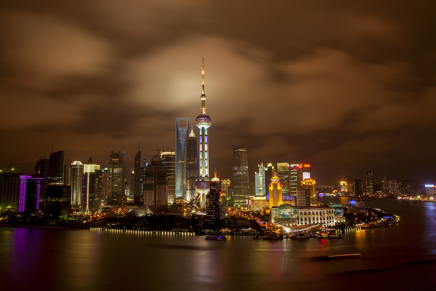 Images of Shanghai's Pudong New Area skyline have been used often in both Chinese and western media as a symbol to illustrate stories about China's economy, projecting an image of modern China. After Pudong was established as a special economic zone in 1993, construction sky-rocketed. Here it is 17 years later on a night in 2010.
