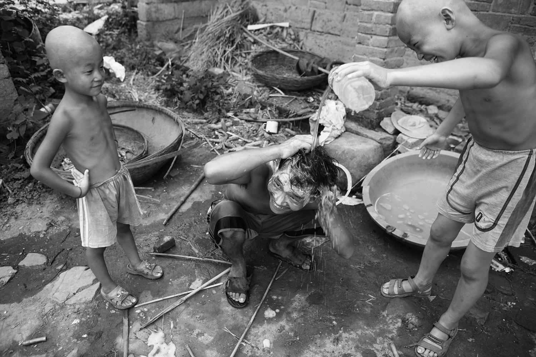 Children bathe before departing.