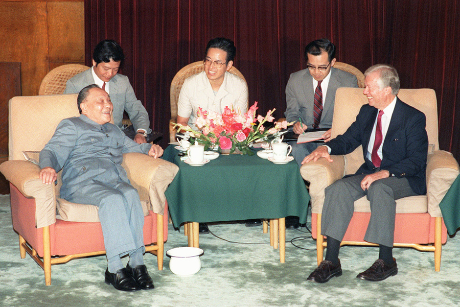 "China's paramount leader Deng Xiaoping confers with U.S. President Jimmy Carter, June 29, 1987 in Beijing, after signing an agreement between China and the Carter Center's Global 2000 program. Carter won the 2002 Nobel Peace Prize for ""his decades of untiring effort to find peaceful solutions to international conflicts."" (Photo by John Giannini/AFP/Getty Images)"