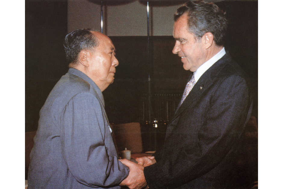 Mao Zedong welcomes U.S. President Richard Nixon, in Beijing in February of 1972, for the first visit of a sitting U.S. President to China. The historic visit, brokered after more than a year of delicate negotiations to begin to restore relations between the two countries, took place against the backdrop of the Cultural Revolution. Their meetings were filmed, and a ten minute segment was broadcast on Chinese national television. (AFP/Getty Images photo)