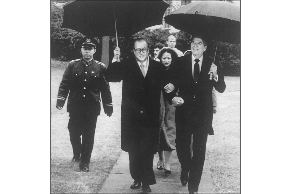 Chinese Premier Zhao Ziyang and U.S. President Ronald Reagan walk arm in arm, as Reagan escorts Zhao to his car through the rain after a meeting at the White House on October 1, 1984. Zhao later became China's President and Communist Party General Secretary, but he was stripped of these posts for opposing the violent crackdown on the protests in Tiananmen Square in 1989. He spent the remainder of his life under house arrest. (AFP/Getty Images photo)