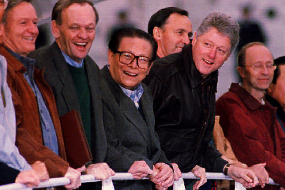 New Zealand's Prime Minister James Bolger, Canadian Prime Minister Jean Chrétien, Chinese President Jiang Zemin, U.S. President Bill Clinton, Australian Prime Minister Paul Keating, and Financial Secretary of Hong Kong Hamish MacLeod depart for their meeting on Blake Island on the final day of the Asia-Pacific Economic Cooperation conference, November 20, 1993. (Photo by Therese Frare/AFP/Getty Images)