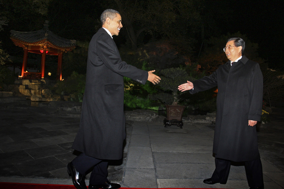 U.S. President Barack Obama is greeted by Chinese President Hu Jintao after his arrival at the Diaoyutai state guest house in Beijing on November 16, 2009. Obama arrived in Beijing from Shanghai for the second leg of his maiden state visit to China. Obama was welcomed at Beijing's international airport by Vice President Xi Jinping (Photo by Elizabeth Dalziel/Pool/AFP/Getty Images)