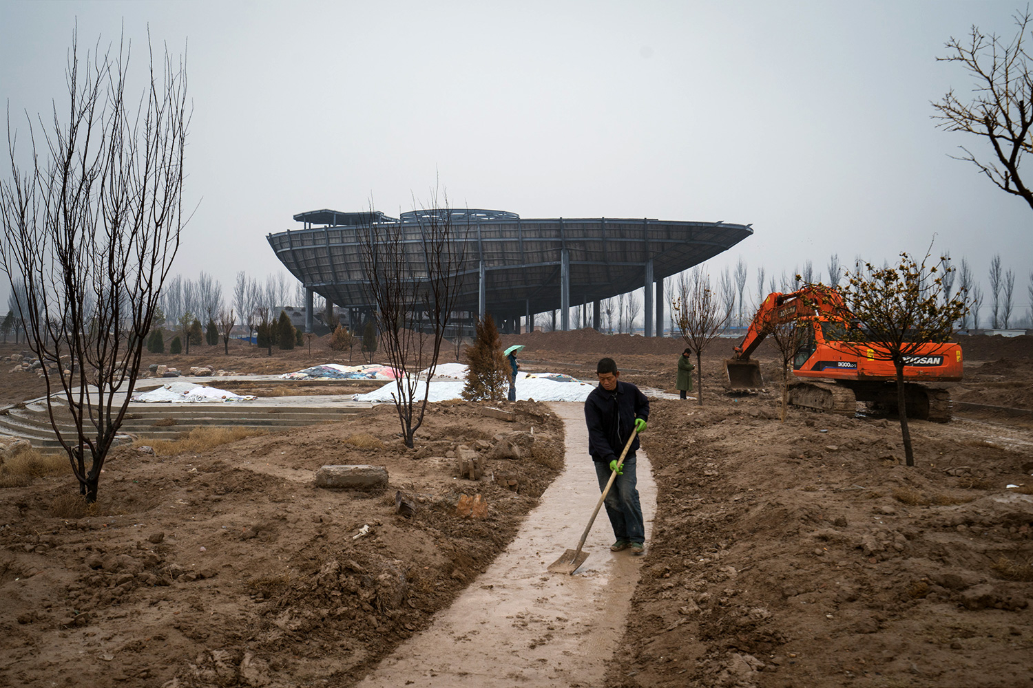 A replica of the Saudi Arabia Pavilion, seen in the background, that was built for the Shanghai World Expo 2010, is one of the buildings being constructed in phase two of construction of the Hui Culture Park. The original was designed to resemble an oil tanker.