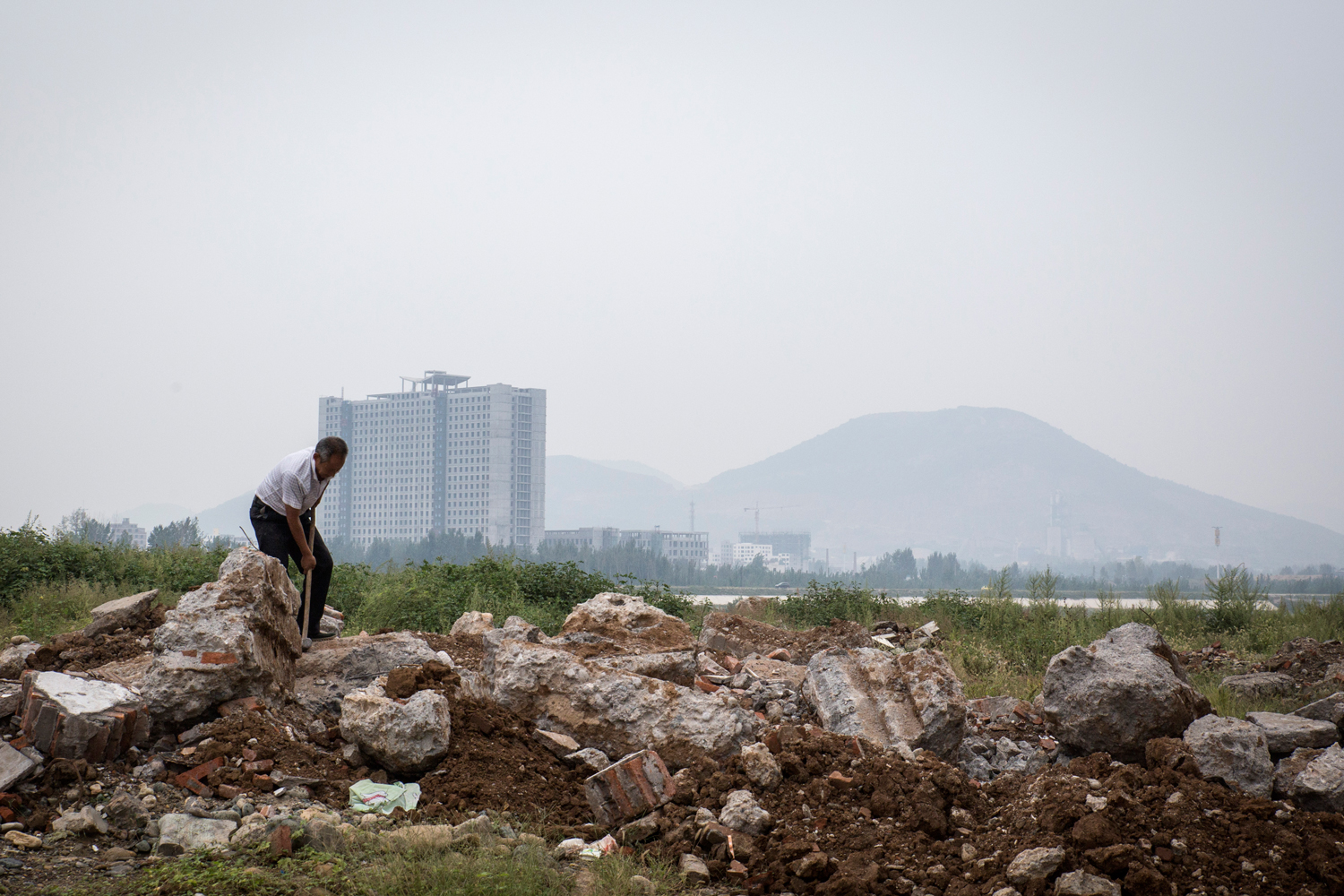 A view of Xichuan. Hundreds of local mines were also ordered to close by the central government, an accountant from Zhengzhou said, to prevent pollution from leaching into water bound for Beijing.