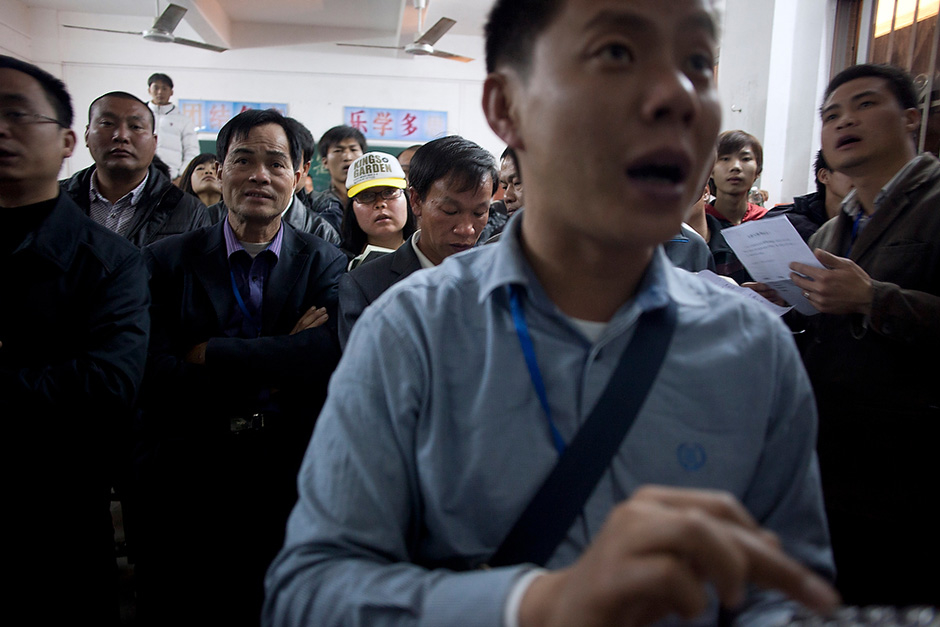 Wukan villagers make a final count of ballots late into the night after the first round of elections.