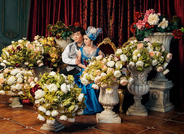 An engaged couple sits on-set at the Dream Castle studio.