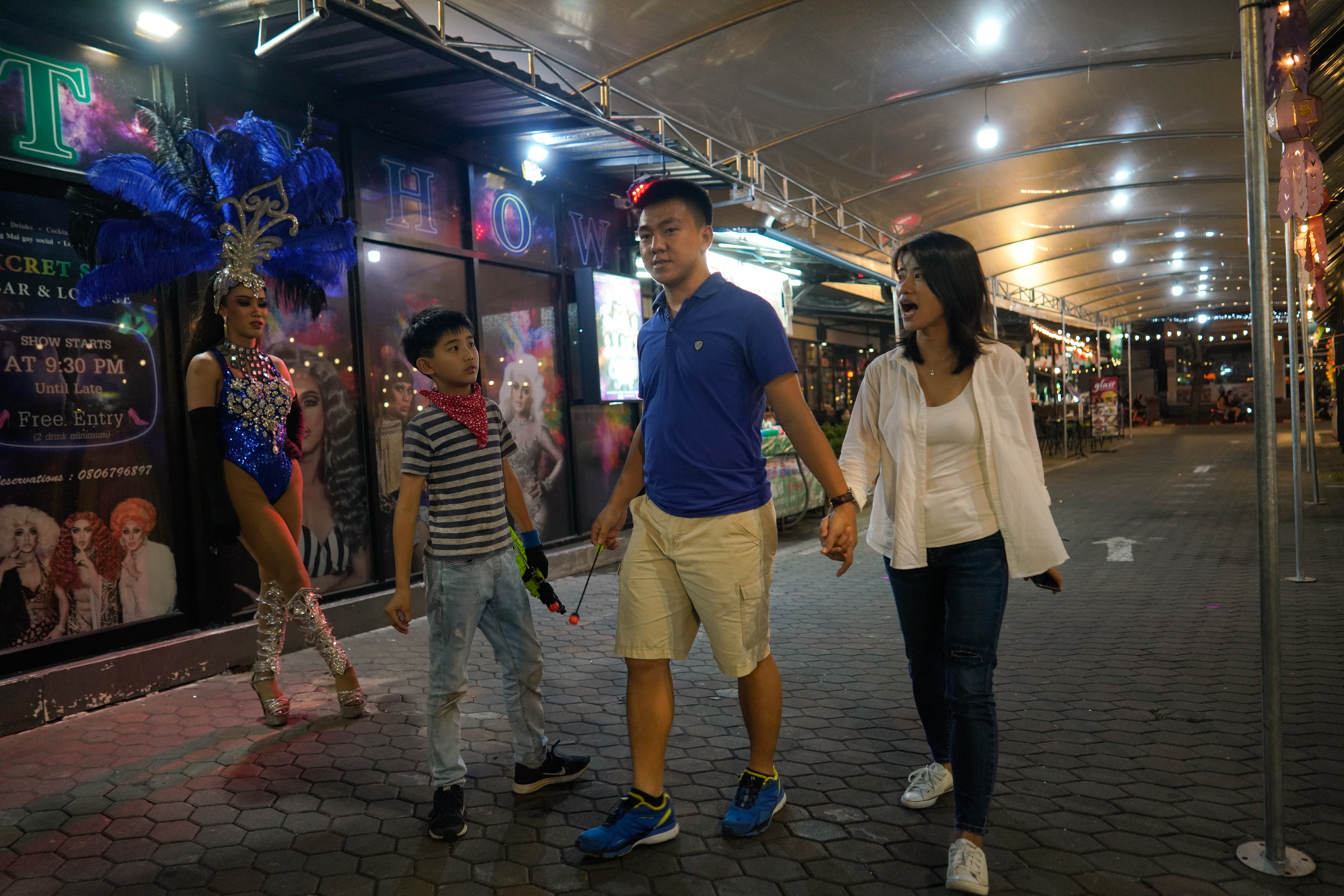 Echo and her family walk home after closing their restaurant for the day in Chiang Mai, January 18, 2019. After Echo's marriage failed in China in 2014, she moved to Chiang Mai with her son, Billy, who was only four. She believes Billy's education in Thailand has made him more brave and outgoing. On January 5 this year, Echo married her boyfriend, Philip, a Thai man of Chinese ancestry.