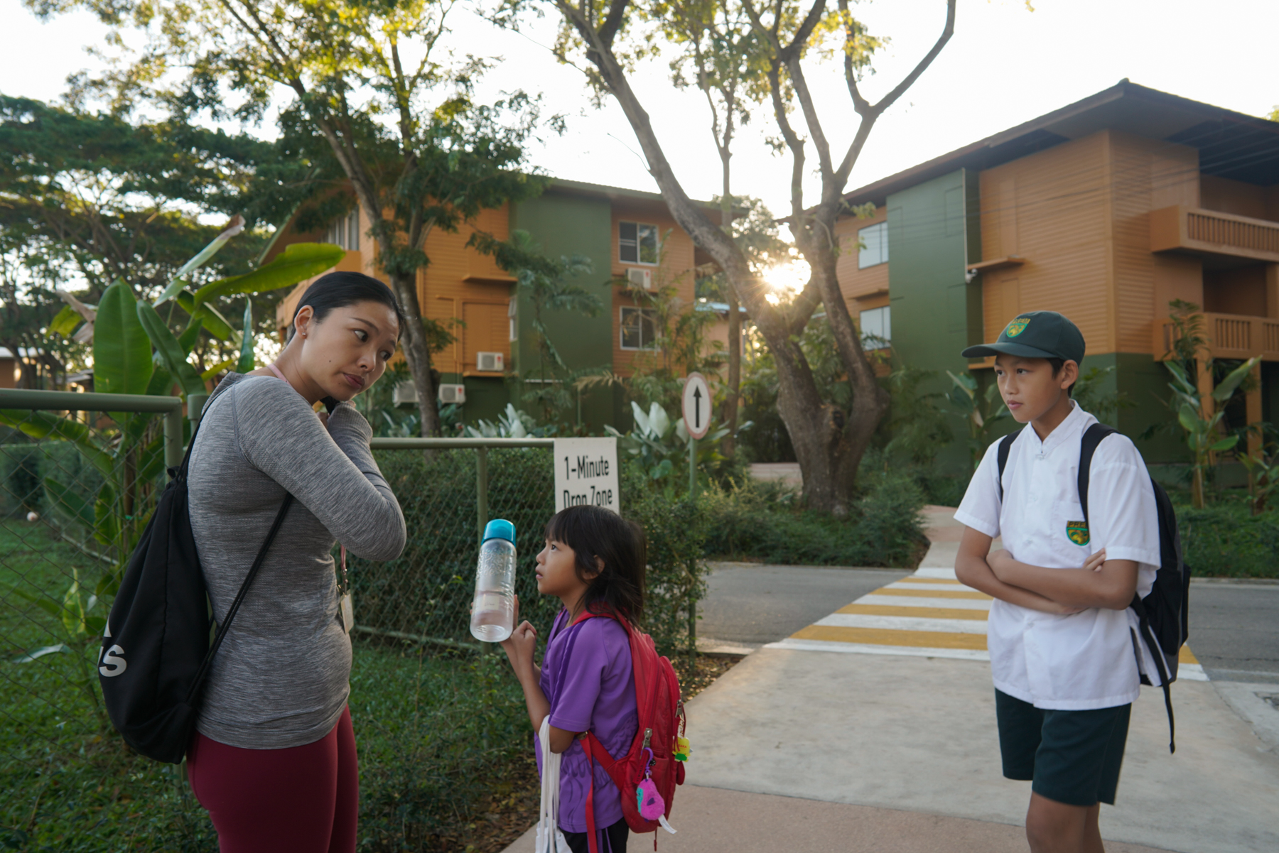 Ding Dian, from Huizhou, Guangdong province, sends her two children off to school, January 16, 2019. Both of them attend Prem Tinsulanonda International School, whose campus features a golf center and a tennis center.