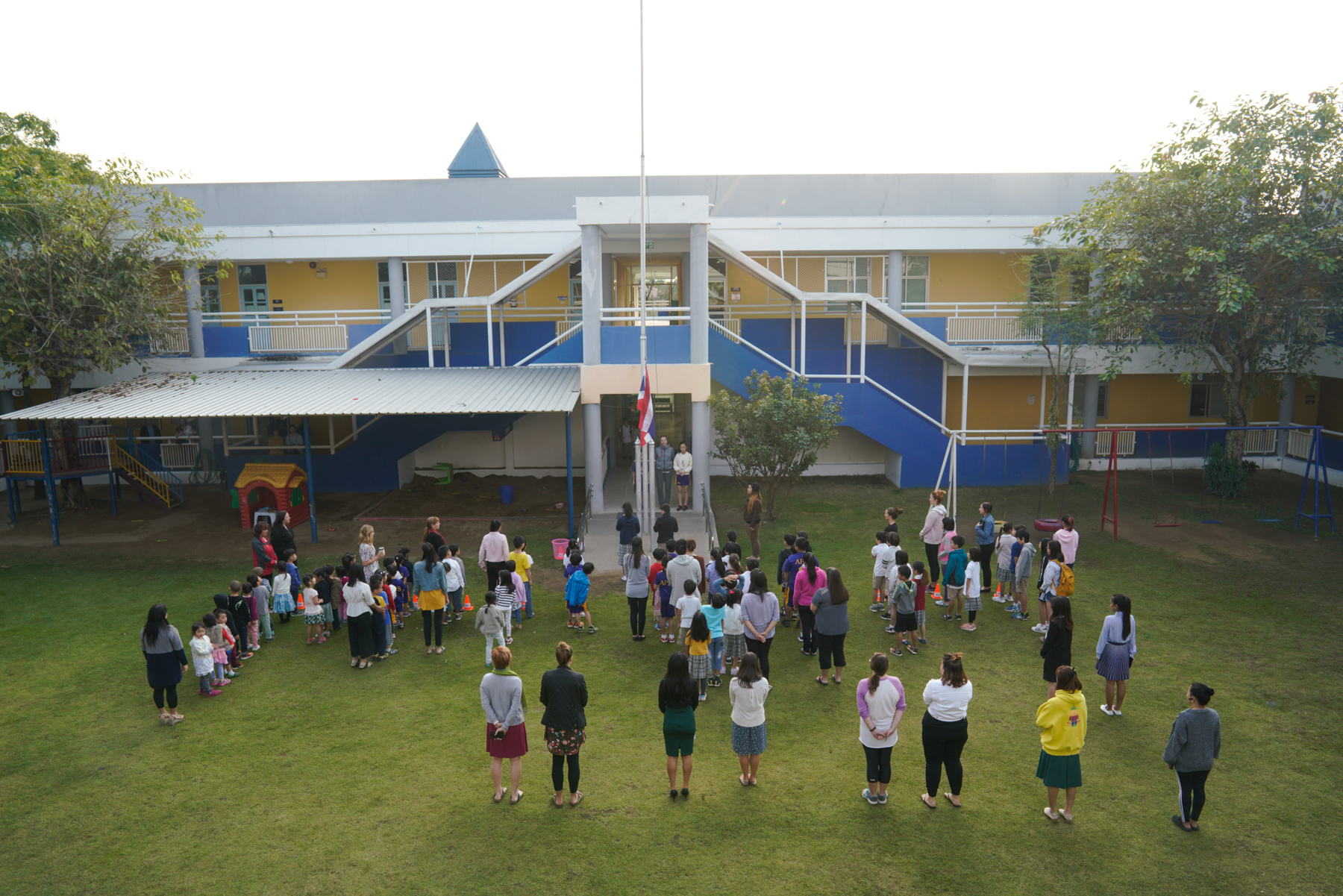 Students and teachers at the American Pacific International School (APIS) gather on the school playground to watch a flag-raising ceremony before their morning classes begin, January 24, 2019. Although schools in Chiang Mai don't release enrollment data on students' nationalities, Chinese parents there estimate that in the past few years several hundred Chinese families have migrated to the Thai city to pursue international education.