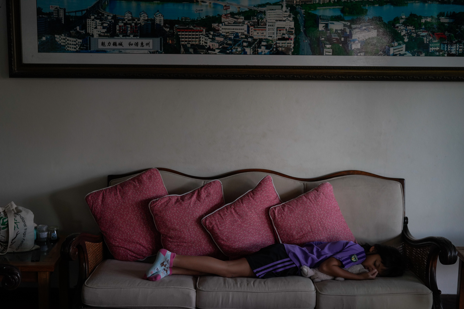 A little after 7:00 a.m., six-year-old Diandian lies on her living room couch before her mother Ding brings her and her 11-year-old brother to school, January 16, 2019.