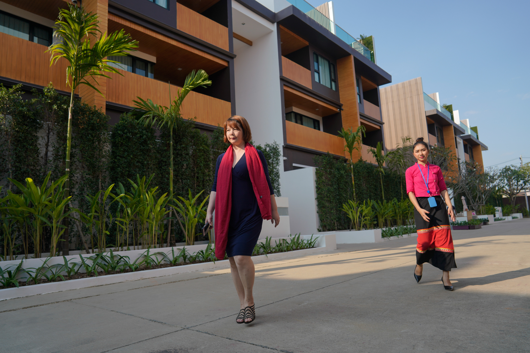 An Lan tours the condos she purchased in Chiang Mai, January 18, 2019. An's condos are rented out as hotel-style apartments by a management company. She receives more than 1 million baht (U.S.$30,000) a year in dividends, enough to cover her son's U.S.$9,700 yearly tuition at Nakornpayap International School (NIS) and the rent for a house they live in near the school.