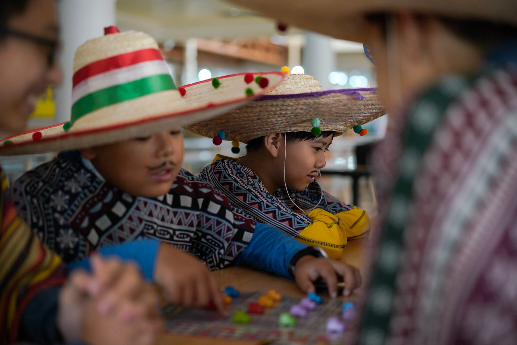 At NIS' International Day celebration, 12-year-old Zou Yanhu and his classmates prepare for a parade in a local approximation of Mexican costumes, January 26, 2019. NIS enrolls students from preschool to high school and offers Advanced Program (AP) courses to prepare them to go to American and Canadian universities.