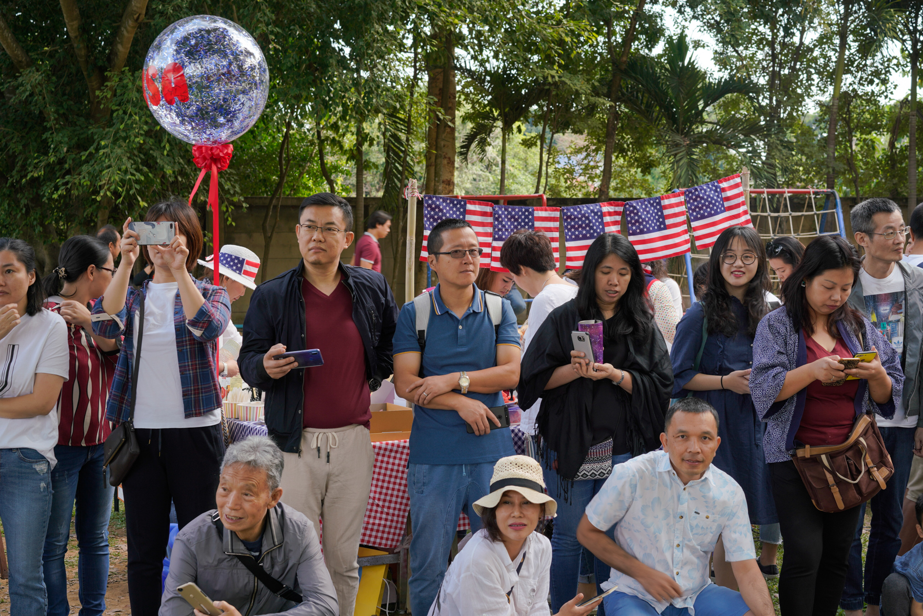 Chinese parents watch as their children participate in NIS' International Day celebration, January 26, 2019. Parents were invited to participate in the events, and they prepared snacks.