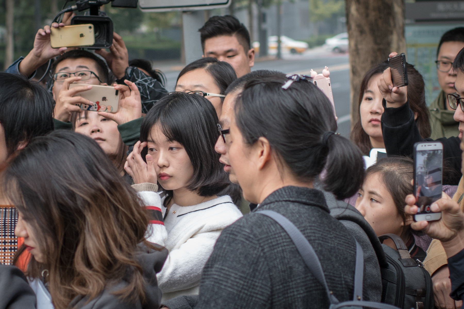 Zhou Xiaoxuan, who accused prominent TV host Zhu Jun of sexual assault, leaves court after a pretrial evidence exchange hearing in the suit Zhu filed against her for defamation, in Beijing, October 25, 2018. In July, Zhou disclosed on her WeChat account that Zhu had groped and forcibly kissed her four years earlier when she was an intern at his television station. Her post went viral.