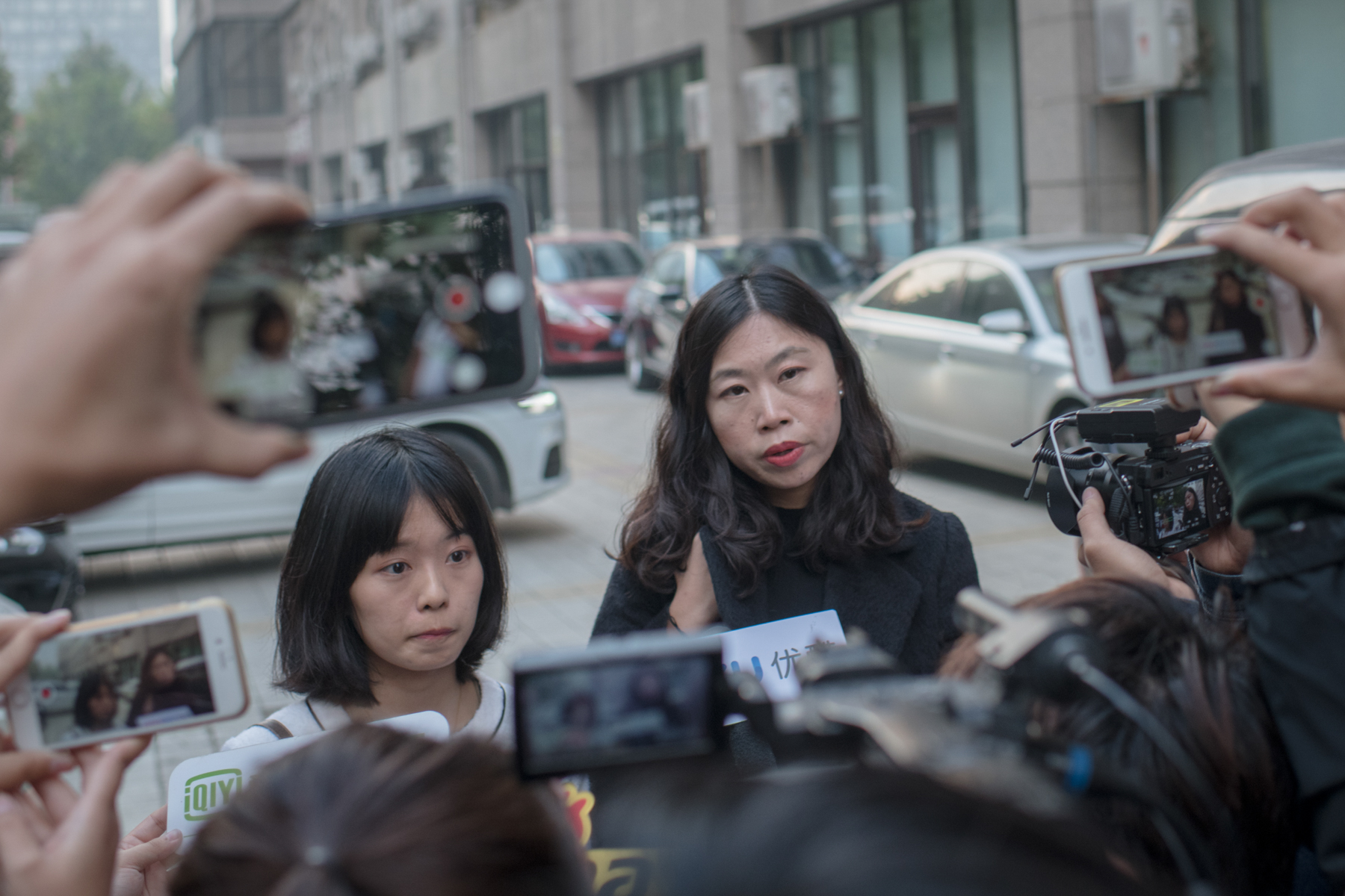 "Zhou and Xu take press interviews after the evidence exchange hearing, October 25. When a reporter at 'Caijing Magazine' searched a database of court judgments run by China's Supreme People's Court looking for cases with the keywords ""sexual harassment,"" ""civil suit,"" and ""right of personal dignity,"" she found such cases had been almost exclusively filed by alleged sexual perpetrators against their victims. The reporter found no instances in which victims won their cases."
