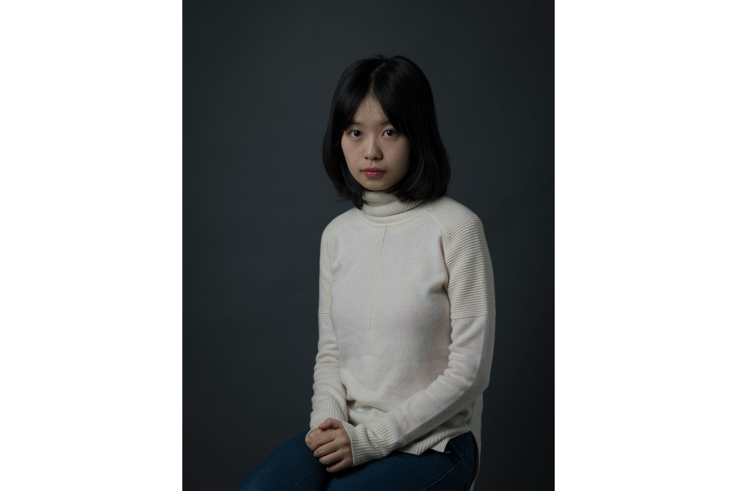 Zhou, 25, poses for a portrait, in Beijing, December 9. On September 25, while she was at one court filing a claim against Zhu for infringement of her right to personal dignity, Zhou received official notification from another court that Zhu had sued her for defamation. Also named in the defamation suit was Xu Chao, a friend of a friend, who had first posted Zhou's accusation on the social media platform Weibo.