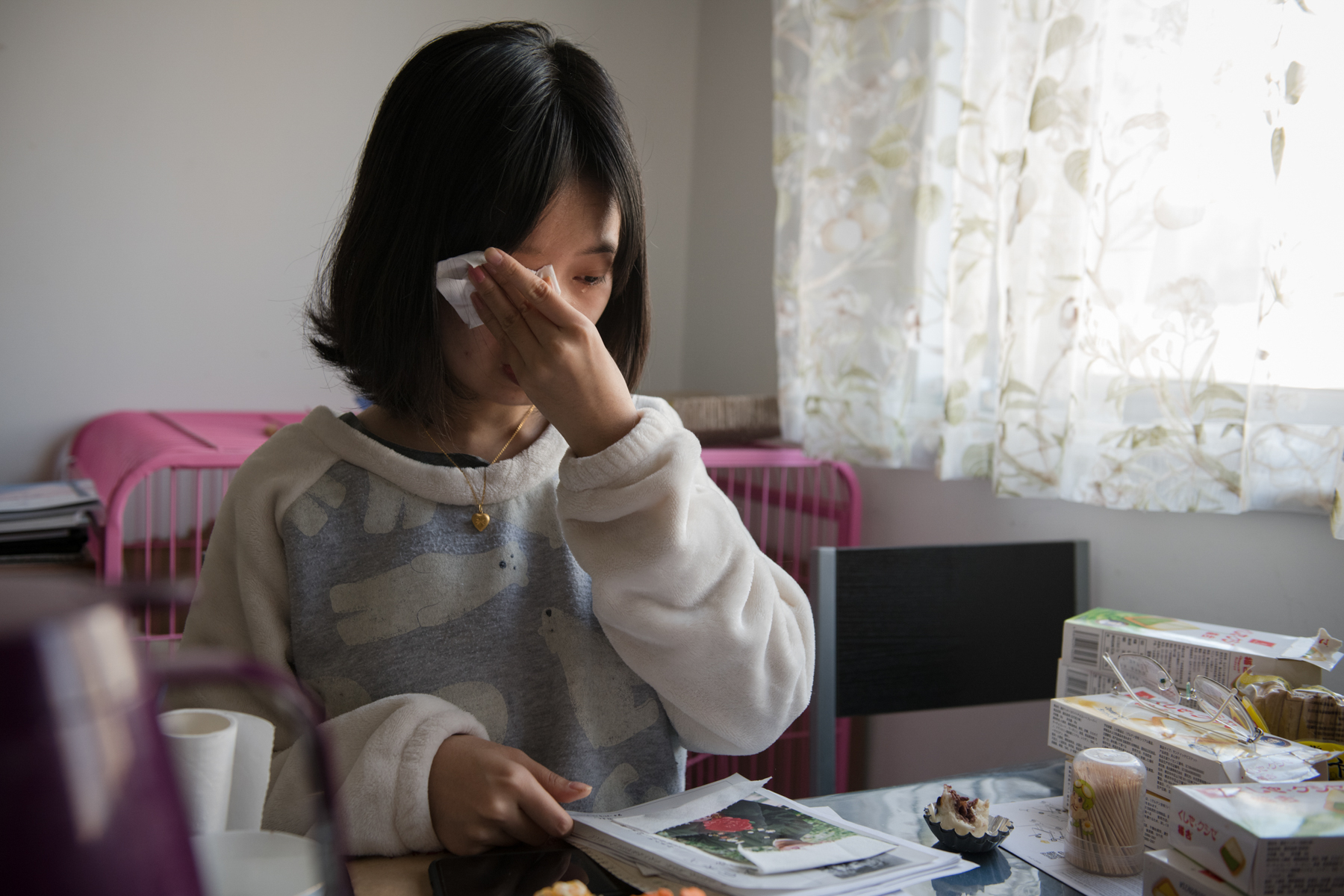 "Zhou cries while talking about her deceased grandfather, December 9. Unusually for a sexual assault victim in China, Zhou went to the police the day after her encounter with Zhu. She says that because she grew up in a loving family, ""I won't be obedient just because someone is older. If they say something wrong, I will definitely fight back."""